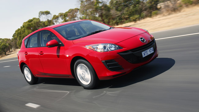 sell my car - mazda 3 red