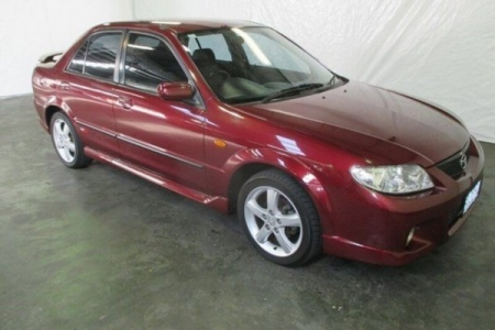 sell my car- mazda 323 red