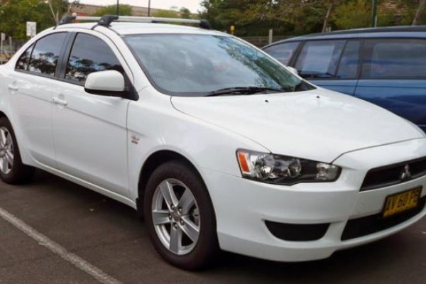 sell my car – mitsubishi lancer white