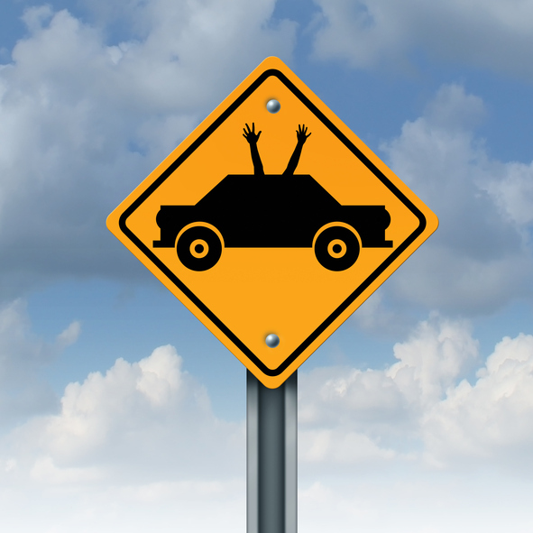 Autonomous driving concept and driverless car safety system symbol as a road traffic sign as an automobile icon with human hands and arms waving up to the sky as a metaphor for hands free autopilot transportation technology.